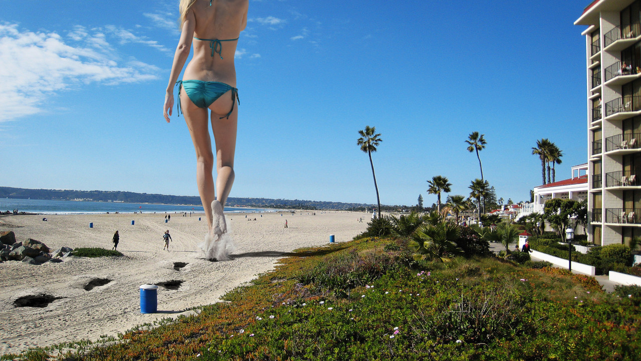 giant girl on beach