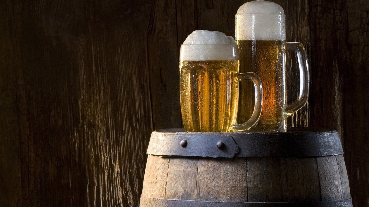 two pints of beer on a keg