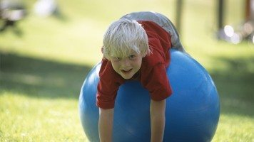 blond-child-on-a-blue-ball