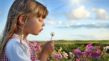 girl-blowing-a-dandelion