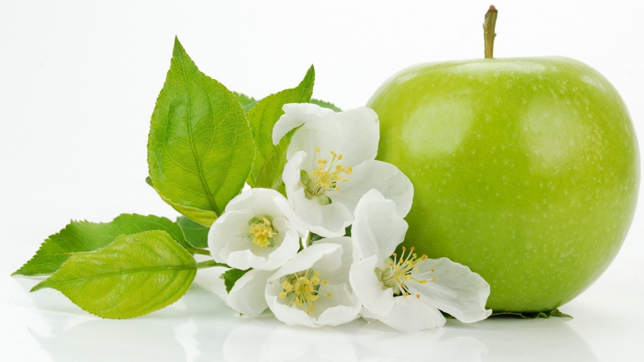 green apple with apple blossom