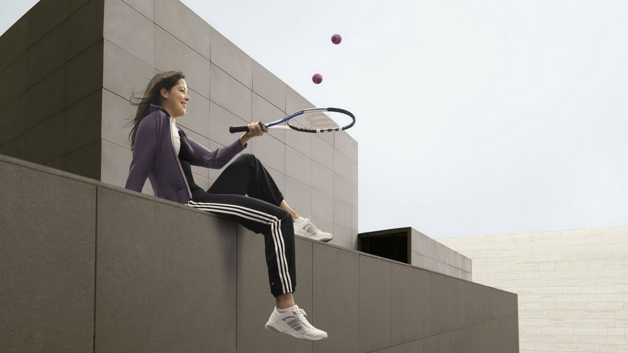 girl playing with tennis racket