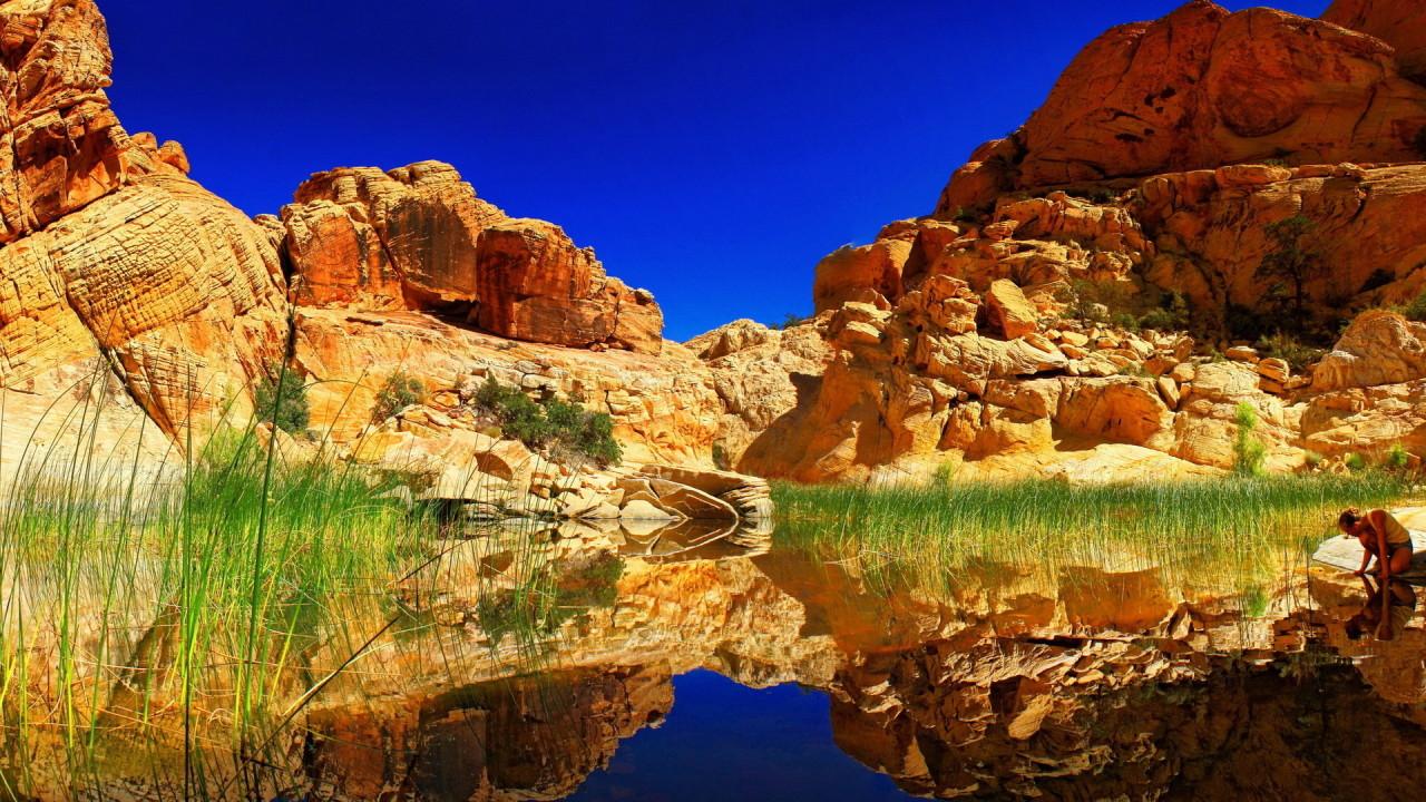 blue sky and reddish rocks