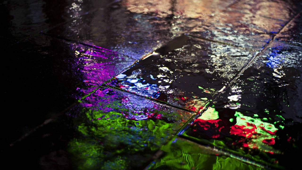 Colored reflections of light on the pavement